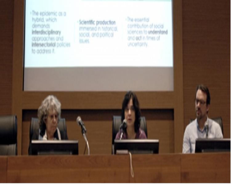 Duas mulheres e um homem sentados para apresentação de seminário